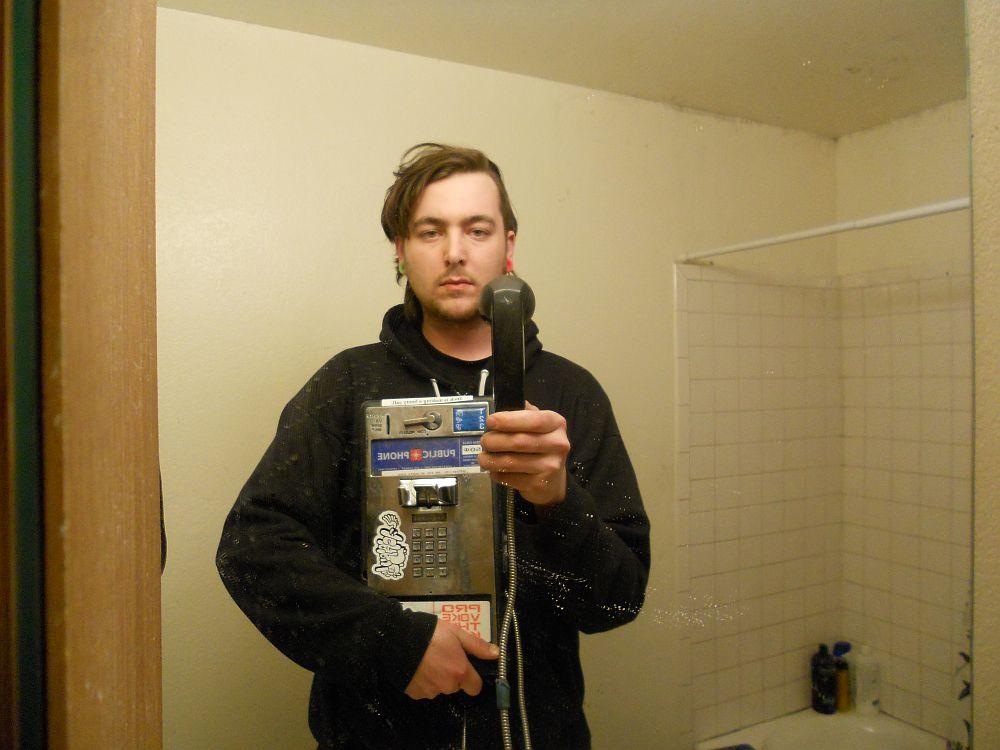 Image Se prendre en photo devant un miroir avec un téléphone