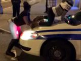 Des filles twerkent sur une voiture de police